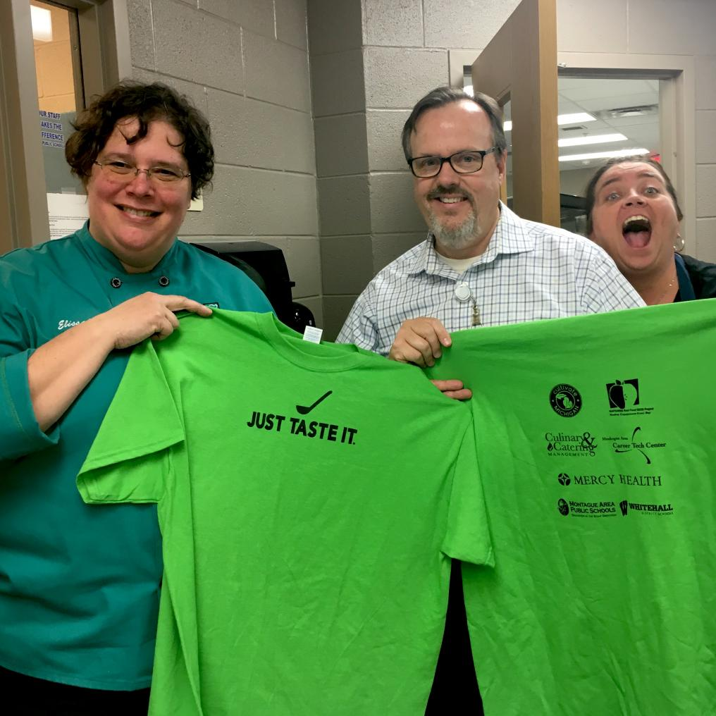 Dan Gorman and colleagues show off the Just Taste It t-shirts!
