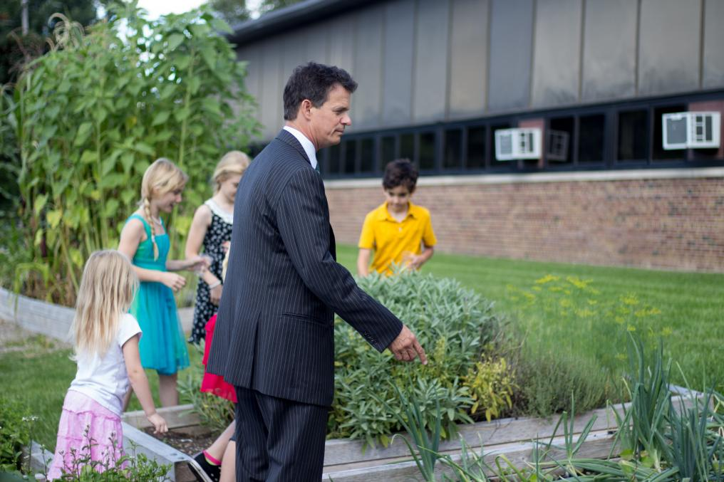 U.S. Representative Trott visits the Waterford School District Garden in 2015